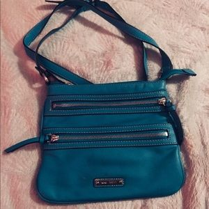 Small Nine West teal colored crossbody